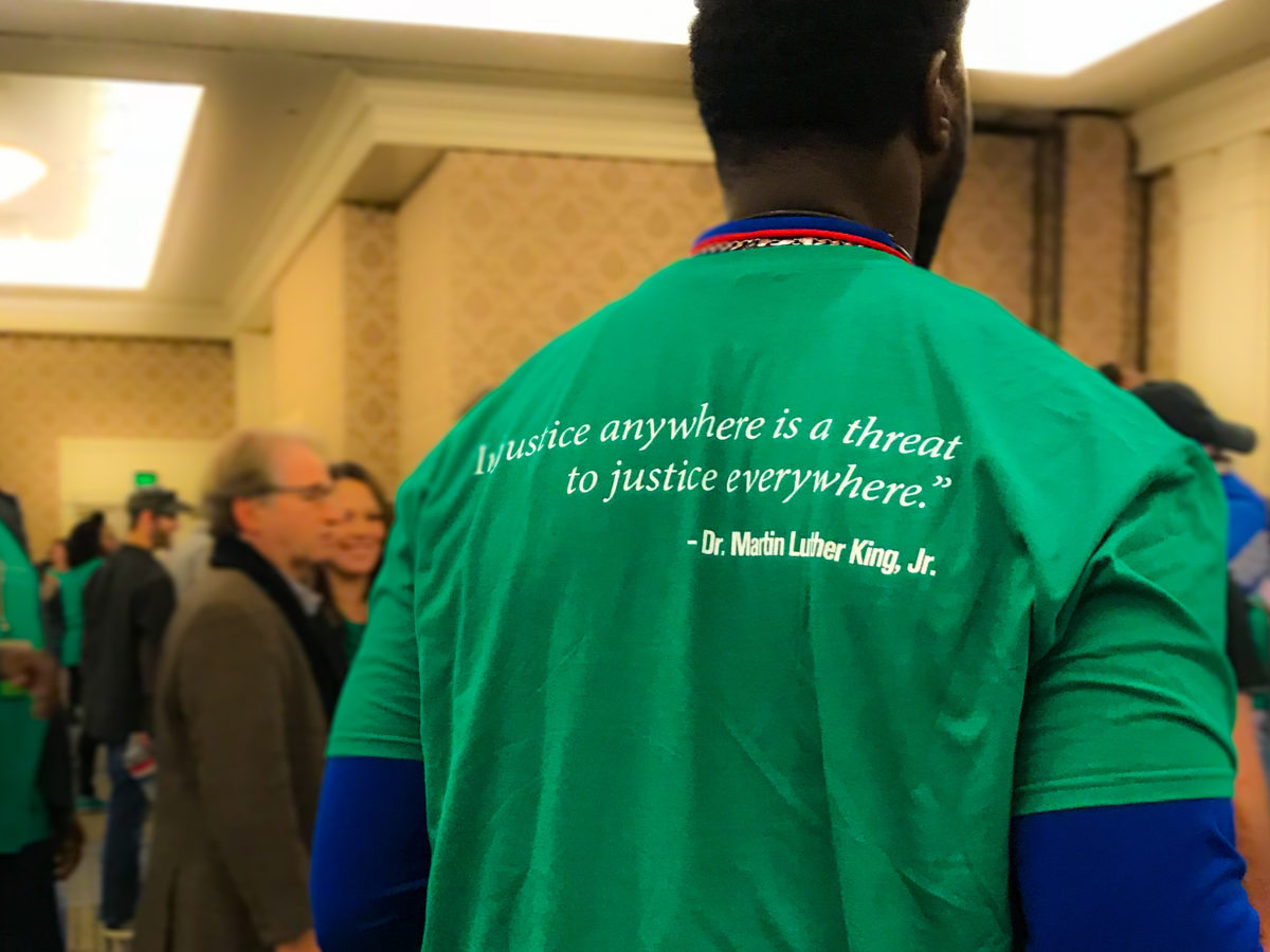 "Conference T-shirt – ""Injustice anywhere is a threat to Justice everywhere."" Martin Luther-King"