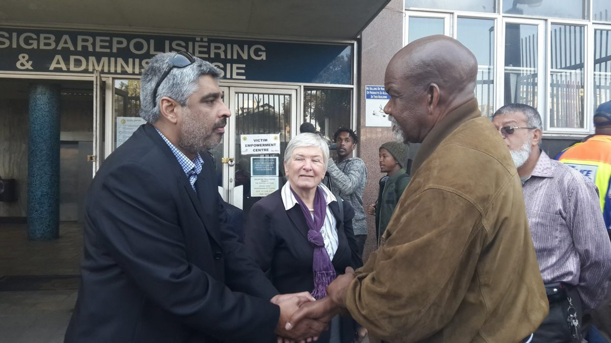 Ahmed Timol's nephew, Imtiaz Cajee, and Phillip Dhlamini meet outside Johannesburg Central Police Station