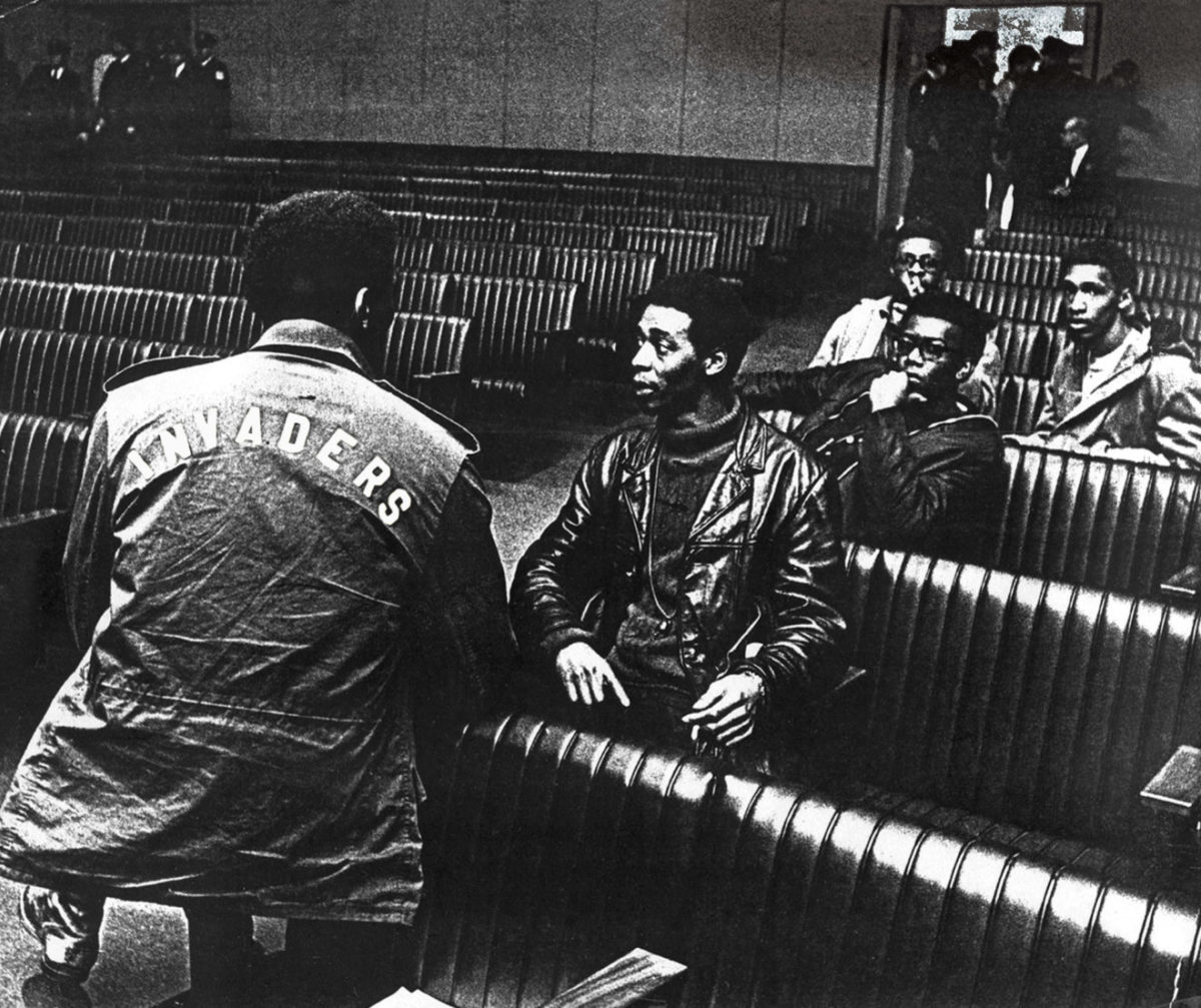 "John Burl Smith, left, with his back to the camera, and Invaders co-founder Charles Cabbage, center, gather with other members of the Invaders at Memphis City Hall, ca. 1968. This photo was used in the official poster and banner for ""The Invaders,"" a documentary directed by Prichard Thomas Smith, which was released in 2016. (Photo courtesy University of Memphis Special Collections)"