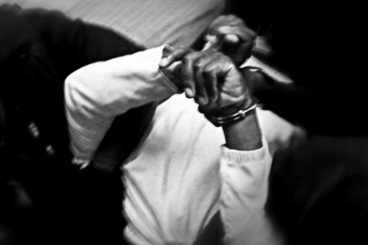 Inmate Bheki Dlamini being restrained for a forced injection of anti-psychotic drugs, as punishment for reported disruptive behavior.