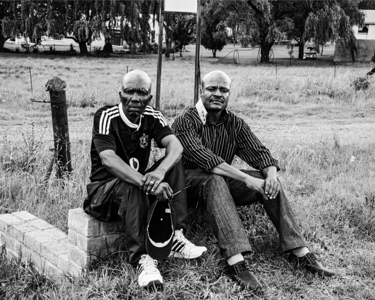 Tsokolo Mokoena and Fusi Mofokeng at the scene of a shoot-out between members of the ANC armed wing and the South African Police, outside Bethlehem. 14 December 2012. Picture: David Goldblatt
