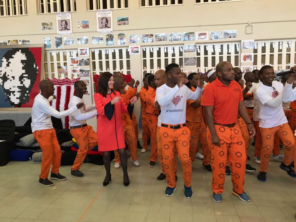 67 Blankets for Nelson Madela founder Carolyn Steyn dancing with inmates at Zonderwater Correctional Centre