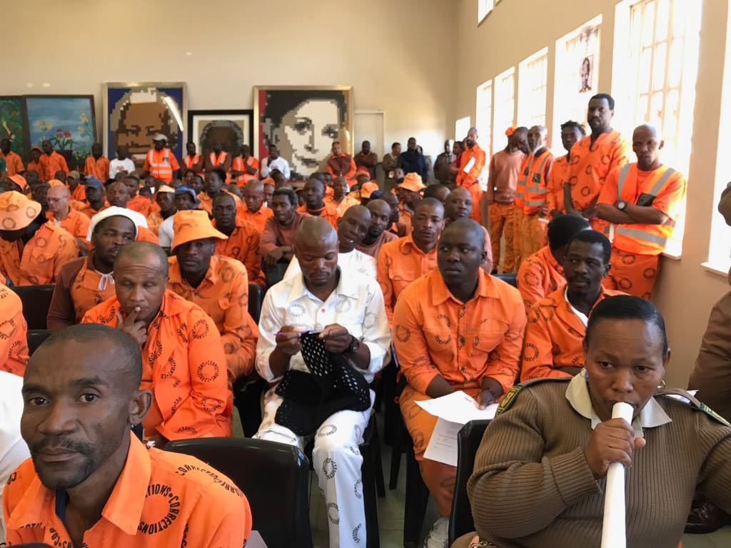 An inmate at Zonderwater Correctional Centre knits his blankets attentively during the event